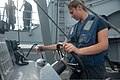 U.S. Navy Engineman Fireman Apprentice Darlene Cortez, right, performs a daily maintenance check on a rigid-hull inflatable boat aboard the guided missile cruiser USS Mobile Bay (CG 53) while transiting 130410-N-LV331-022.jpg
