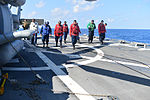 U.S. Sailors conduct a foreign object damage walk Aug. 7, 2013, before flight operations on the flight deck of the guided missile destroyer USS Truxtun (DDG 103) in the Atlantic Ocean 130807-N-YZ751-060.jpg