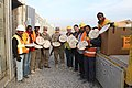 U.S. Soldiers and civilians pose for a photo while holding frozen pizzas Jan. 20, 2014, at Kandahar Airfield, Afghanistan 140120-A-MH103-325.jpg