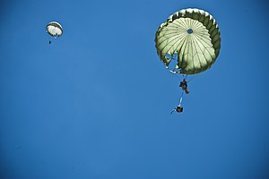 United States Air Force Tactical Air Control Party - An Air Liaison Officer with the 14th Air Support Operations Squadron, parachutes to the ground during a joint forcible entry exercise May 31, 2013, at the Nevada Test and Training Range at Nellis Air Force Base, NV.