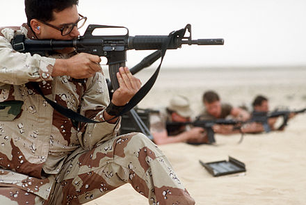 A USAF security policeman aims his Colt Commando during a live-fire demonstration, part of Operation Desert Shield. Note: large flash hider USAF MP with Colt Commando.JPEG