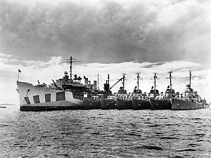 USS Dixie (AD-14) with destroyers off Leyte in 1945 (NH 905541).jpg