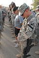 US Army 51759 Soldiers bow their heads during a moment of silence before going on a commemorative march on Forward Operating Base Warrior, Kirkuk, Iraq, Sept. 11. The march gave Soldiers the opportunity to reflect.jpg