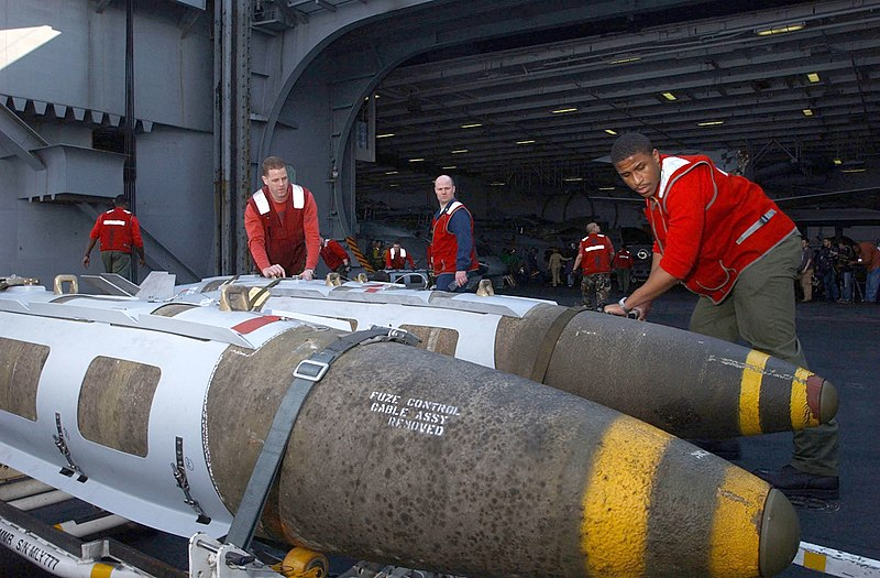 File:US Navy 030321-N-4953E-078 Aviation Ordnancemen direct a 2,000-lb. Joint Directional Attack Munition (JDAM) from the magazine onto aircraft elevator one aboard USS Harry S. Truman (CVN 75).jpg