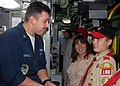 US Navy 031121-N-0879R-002 Machinist Mate 3rd Class Ray Garcia talks about the role of submarines with a boy scout.jpg