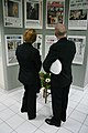 US Navy 040325-N-5821W-003 Aviation Maintenance Administrationman 2nd Class Susan Schmitt, left, and Lt. j.g. Chris Newell look over copies of the front pages of newspapers featuring the events occurring on Sept. 11, 2001 at a.jpg