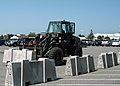 US Navy 040513-N-0130O-022 Equipment Operator 2nd Class Mikko Wimari, of Gresham, Ore., uses a forklift to position a 3,500 pound concrete barrier.jpg