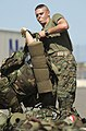 US Navy 040705-N-6811L-051 fc. Pierre Galarza from Tampa Bay, Fla., stages gear for the 3rd Marine Battalion Landing Team.jpg