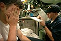US Navy 040822-N-2653P-357 Machinist's Mate 2nd Class Michael Foster, wipes his face after a long day of Bravo Trials.jpg