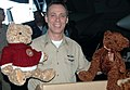 US Navy 050106-N-9403F-001 Command Master Chief J. O'Bannon holds toy bears during a toy drive held aboard USS Abraham Lincoln (CVN 72).jpg
