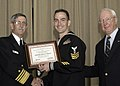 US Navy 050224-N-7281D-085 Vice Adm. LaFleur, left, and Vice Adm. (Retired) John Nyquist present Gas Turbine Technician 1st Class Robert S. Whynot a certificate for being chosen as USS Benfold (DDG 65) 2005 Sailor of the Year.jpg