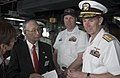 US Navy 050520-N-9851B-006 Commander Brad Smith, center, explains operations on the bridge of USS Fitzgerald to Mayor of Shimoda City, Mr. Naoki Ishii, and Commander Naval Forces Japan Rear Admiral Frederic Ruehe.jpg