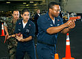 US Navy 050922-N-6495K-019 Operations Specialist 2nd Class Nelson Gonzalez, center, and Operations Specialist 1st Class Alonzo Woods, right, receives instruction from Master-at-Arms 1st Class Clarence Wright.jpg
