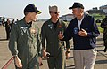 US Navy 051009-N-2945C-048 Commanding Officer, Naval Air Station Joint Reserve Base, New Orleans, Capt. A.J. Rizzo, and Executive Officer, Cmdr. Brent Bateman speak with former President George H. Bush.jpg