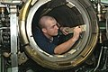 US Navy 060117-N-5863B-129 Machinist's Mate 2nd Class Robert Boon performs maintenance on the torpedo weapons system aboard the Los Angeles-class fast attack submarine USS Norfolk (SSN 714).jpg