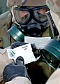 US Navy 060207-N-0553R-003 Members of Naval Mobile Construction Battalion One's (NMCB-1) Survey Team follow step by step instructions while using a M-256 Chemical Detector Kit.jpg