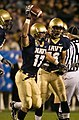 US Navy 061202-N-0696M-121 Navy Midshipmen safety Jeff Deliz (17), from Clinton Township, Mich., celebrates an interception during the 107th playing of the Army vs. Navy football game.jpg
