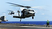 US Navy 090328-N-9928E-053 An MH-60S Sea Hawk helicopter lands aboard the aircraft carrier USS John C. Stennis (CVN 74)