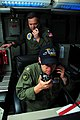 US Navy 090618-N-3946H-038 Cmdr. Dan Rader, combat direction center officer, observes as Tactical Action Officer, Lt. Cdr. Richard Schmaeling, reacts to training events aboard the aircraft carrier USS Nimitz (CVN 68).jpg