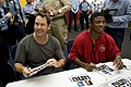 US Navy 090713-N-0696M-133 D.B. Cooper and All-Pro NFL running back Warrick Dunn sign autographs aboard the aircraft carrier USS Ronald Reagan (CVN 76) aboard the carrier underway in the Gulf of Oman.jpg