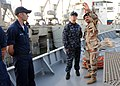 US Navy 090929-N-7088A-216 Lt. Cmdr. Jennifer Forbus, commanding officer of the mine countermeasures ship USS Dextrous (MCM 13) and her crew, tour the Iraqi ship the Fateh with Iraqi navy Capt. Ali Meta'ab Glass in Umm Qasr, Ir.jpg
