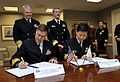 US Navy 100223-N-8273J-009 Vice Adm. Mark Ferguson, Deputy Chief of Naval Operations for Manpower, Personnel, Training and Education, signs a Military Personnel Exchange Program memorandum of agreement between the U.S. Navy and.jpg