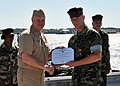 US Navy 100429-N-4267W-205 Chief of Naval Operations (CNO) Adm. Gary Roughead presents Cmdr. Bruce Nevel with the Bronze Star Medal.jpg