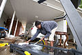 US Navy 100510-N-5319A-001 Enizaedh Kungu cleans off her treadmill after severe flooding hit Naval Support Activity Mid-South.jpg