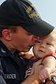 US Navy 100827-N-5292M-031 Machinist Mate 3rd Class John Scherder kisses his eight-month-old daughter goodbye before boarding the amphibious transport dock ship USS Ponce (LPD 15) as the ship prepares to depart Naval Station No.jpg