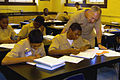 US Navy 101021-N-0437M-006 Rear Adm. Robert Kamensky, vice commander of Submarine Force, looks over the physics work of a Navy Junior ROTC freshman.jpg
