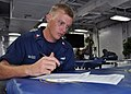 US Navy 101109-N-3620B-022 Boatswain's Mate 2nd Class Kerry McGee takes a medical level-of-knowledge examination aboard the amphibious transport do.jpg