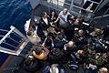US Navy 101210-N-9626Y-004 A group of international media interviews USS George Washington's (CVN 73) Commanding Officer, Capt. David Lausman on th.jpg