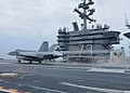 US Navy 110613-N-DS193-013 An F-A-18E Super Hornet assigned to the Eagles of Strike Fighter Squadron (VFA) 115 conducts a touch-and-go landing aboa.jpg