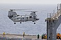 US Navy 110709-N-RC734-069 A CH-46E Sea Knight lifts off from USS Comstock (LSD 45).jpg