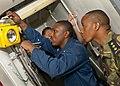 US Navy 110820-N-OV802-037 A Sailor demonstrates a battle lantern spot check.jpg