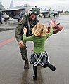 US Navy 111119-N-VE260-063 Cmdr. David Culpepper, commanding officer of Strike Fighter Squadron (VFA) 195, greets his daughter during a homecoming.jpg
