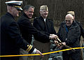 US Navy 120126-N-CL698-026 Barry Pepich, Capt. William Power and Tom Flag cut the ribbon at a ceremony for the completion of the Beaver Creek Estua.jpg