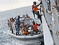 Ugandan service members board a target vessel during exercise Cutlass Express 2013 in the Gulf of Tadjoura off the coast of Djibouti Nov. 14, 2013 131114-F-NJ596-189.jpg