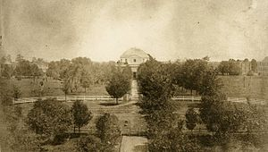 University of Alabama - View of the Quad in 1859. The Rotunda can be seen at center, with the halls visible in the background. All buildings depicted were destroyed on April 4, 1865.