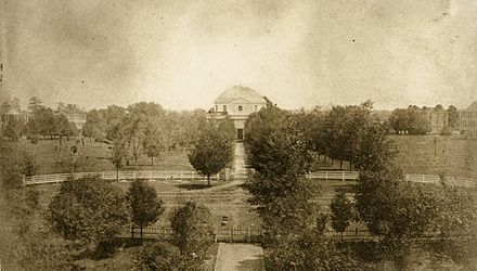 View of the Quad in 1859. The Rotunda can be seen at center, with the halls visible in the background. All buildings depicted were destroyed on April 4, 1865. - University of Alabama
