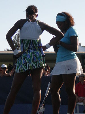 Venus (left) and Serena Williams during their ...