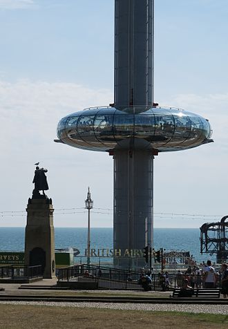 British Airways i360 - View of i360 from Regency Square. Ruins of the West Pier just visible on the right
