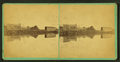 View of unidentified buildings, including a covered bridge, reflected in a river, by William M. Lombard.png
