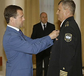 "Order of Naval Merit (Russia) - Captain 2nd grade Viktor Lapshin being decorated with the Order ""For Naval Merit"" by President Dmitry Medvedev on July 13, 2009 for distinction in the fight against Somali pirates. (Photo www.kremlin.ru)"