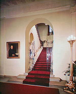 Grand Staircase (White House) - Charles Follen McKim's Grand Staircase looking north, northwest seen from the Cross Hall photographed during the administration of Harry Truman before reconstruction.