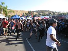 3f3bfee4a9 Attendees moshing in a circle pit on the 2010 tour.