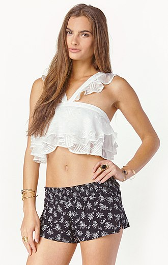 Crop top - A young woman in a frilly white crop top