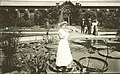 Woman playing violin, standing on lily pad at Shaw's Garden (Missouri Botanical Garden), in front of Linnean House.jpg