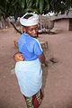 Woman with sleeping baby on her back Gambia.jpg