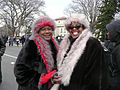 Women with red and pink fake fur scarves and hats at Inauguration 2013.jpg